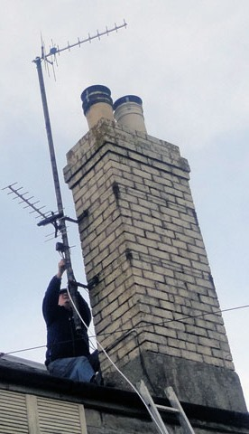 Steve up his ladder fitting a new TV aerial in Bristol